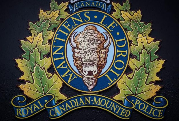 "The RCMP logo is seen outside Royal Canadian Mounted Police ""E"" Division Headquarters in Surrey, B.C."